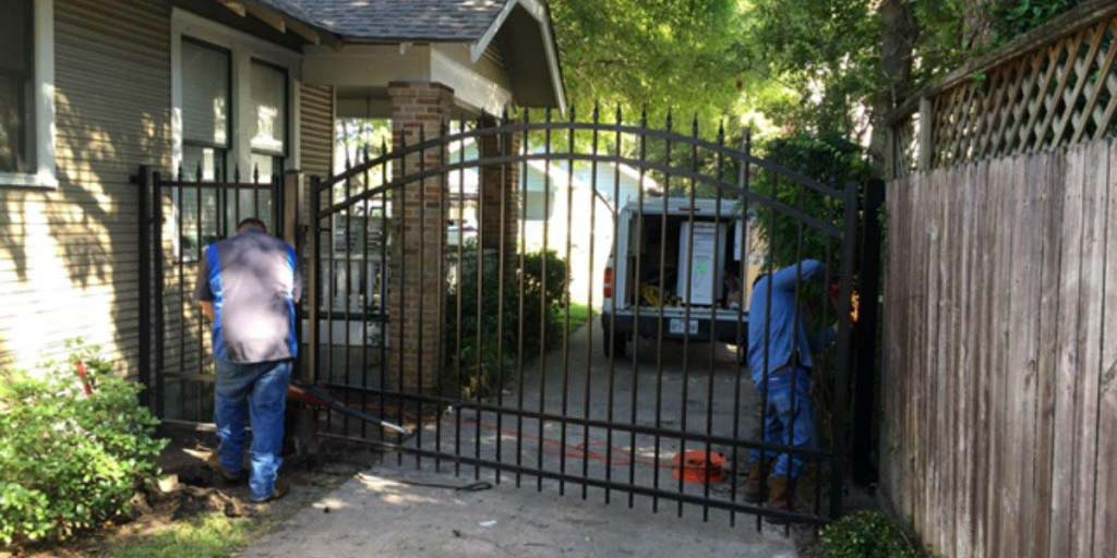 Men repairing gate in Houston TX